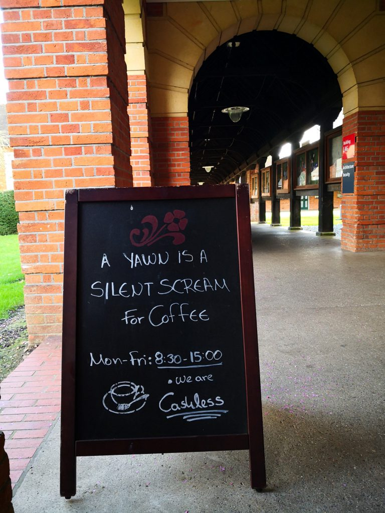 A photo of Architecture cafe signage for coffee