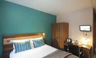Cedars Hotel double ensuite bedroom with desk and TV
