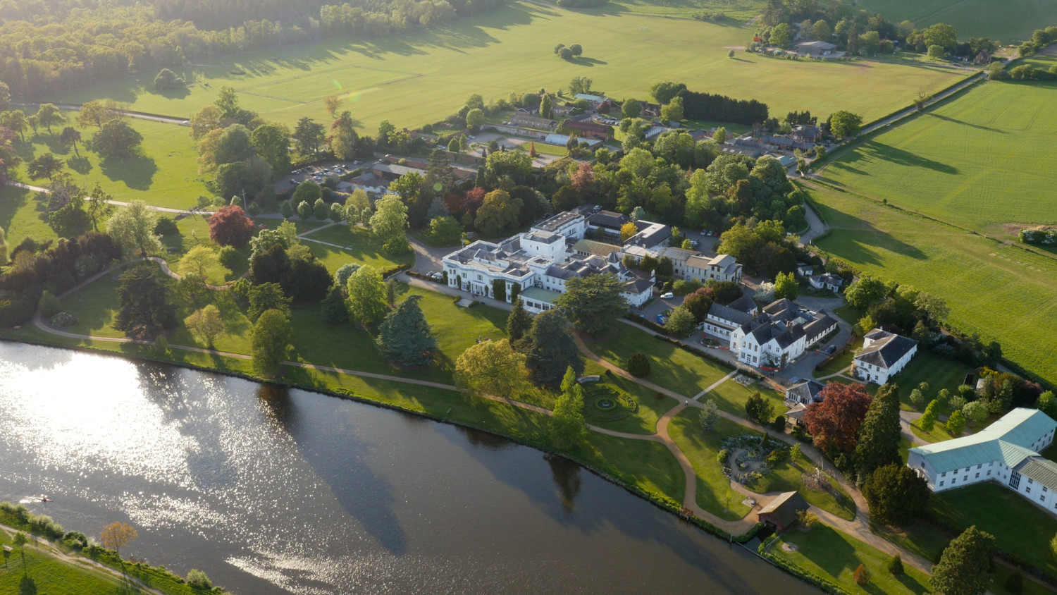An aerial photo of Henley Business School campus in Greenlands alongside the River Thames