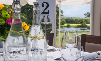A photo of Henley Greenlands heyworth restaurant table with glass water bottles