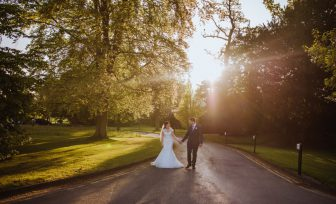 A wedding photo of a couple walking along the main pathway