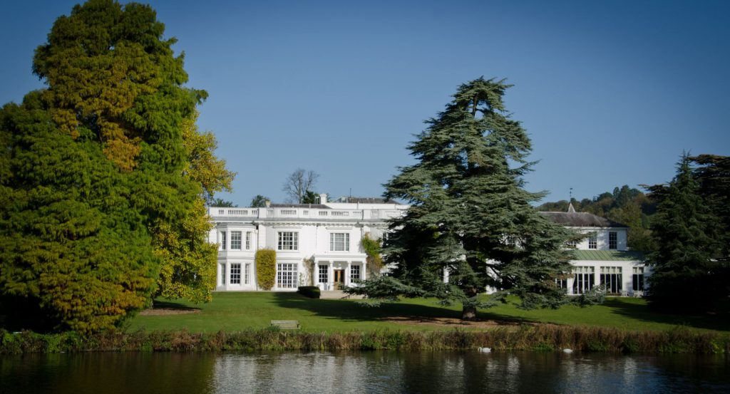 A photo of Henley Greenlands white building from the River Thames