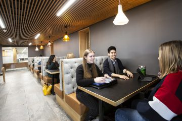 A photo of students in the Library Cafe