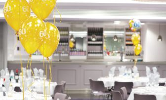 A photo of Meadow Suite with 60th birthday balloons