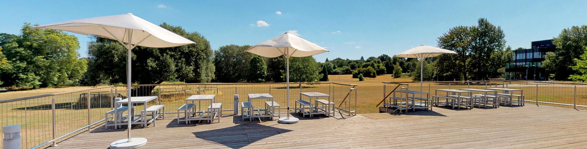 A photo of Meadow Suite decking area with view of the meadow