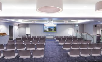 A photo of the Meadow Suite in lecture theatre chairs setup
