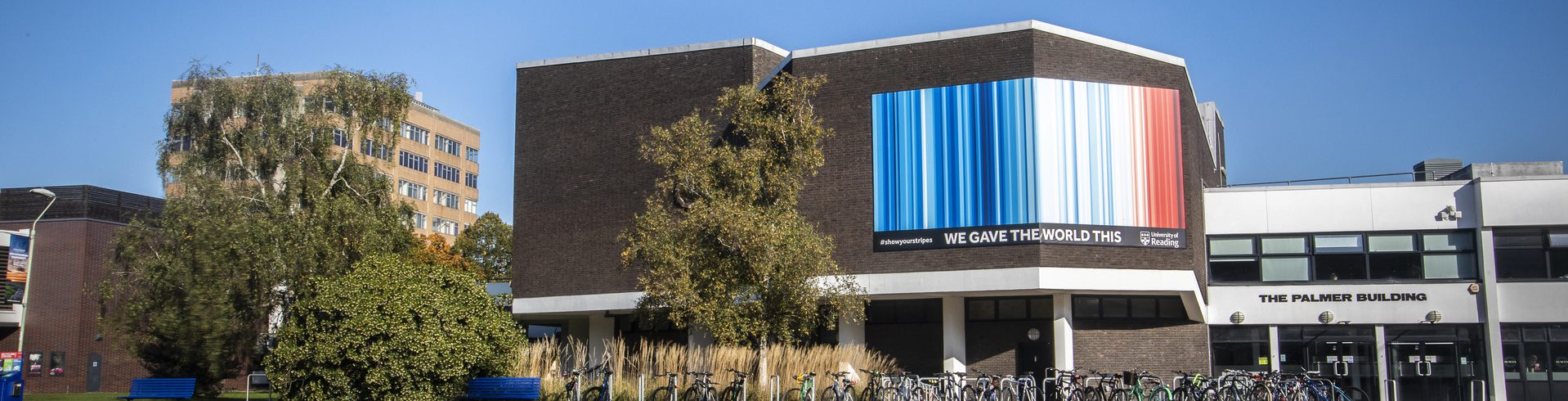 The climate stripes graphic on the Palmer Building on Whiteknights campus.